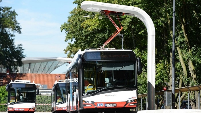 All electric buses in Hamburg with charging station - eco urban transport and motoring