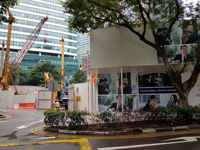 Construction site entry for Singapore's CapitaSpring from Capitaland is Progressing