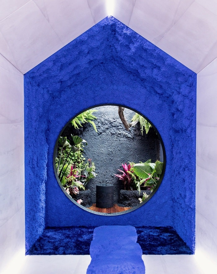 Inside blue and planted TINY HOUSE by fernando mastrangelo in New York City Time square